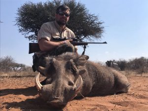 Warthog by Wildebeest by Cameron Fowler,USA,May 2017